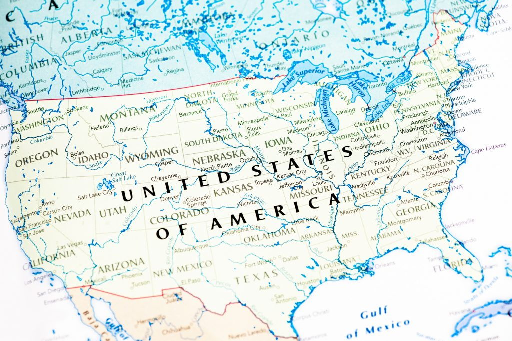 Photo map of USA. Shallow depth of field, focus on the United State of America word of the map and the area nears it.